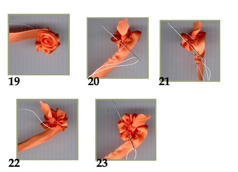 Роза из ткани, ленты, бумаги.
